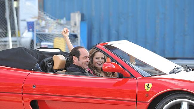 Robert Mammone channels Tony Mokbel's love of the good life with Madeleine West as his love interest, Danielle McGuire. Picture: Channel Nine