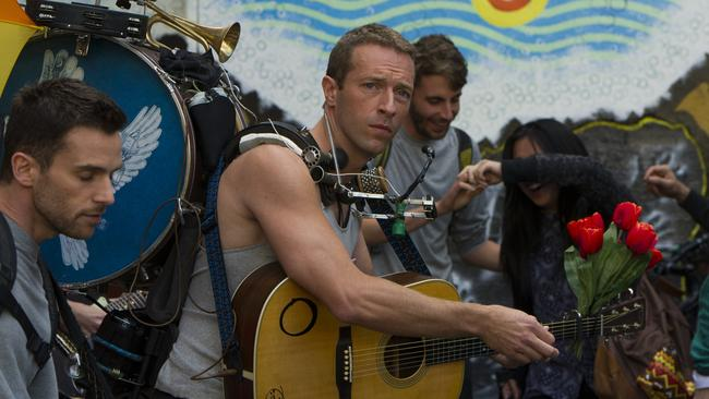 Chris Martin pauses during the shoot in King Street. Picture: Chris McKeen