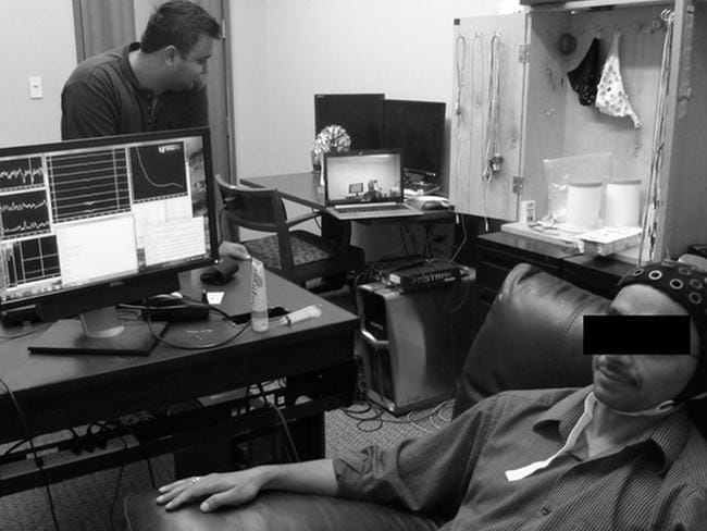 "EEG setup ... EEG signals being recorded from a subject (the ""Sender"") as the subject watches the computer game. Picture: PLOS ONE"