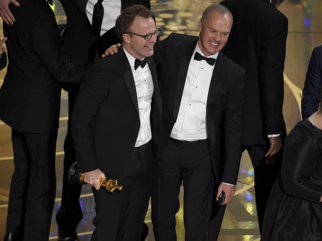 Michael Keaton accepts the award for best picture for Spotlight.