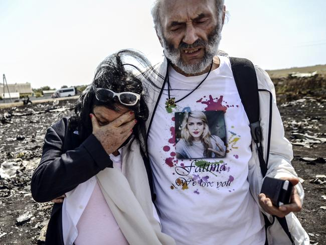 More grief ... the parents of Fatima Dyczynski, Jerry and Angela, were asked for more medical details to help identify her in Amsterdam before they continued on to the crash site in Ukraine.