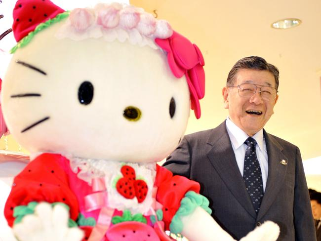 Setting record straight ... President of Japanese character business giant Sanrio, Shintaro Tsuji (R), smiling as he poses with character Hello Kitty (L).
