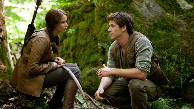 Jennifer Lawrence and Liam Hemsworth in a scene from The Hunger Games.