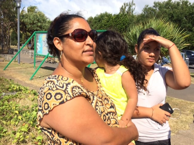 Promise to victims' families ... Maita Nanine with daughters Lea, 13, and Liana, 3. Ms Nanine has said the locals will keep looking and try to find the answers for the families.