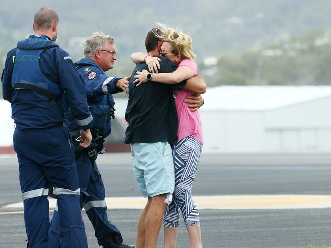 Fishing boat survivor Ruben McDornan is reunited with his wife Sammy at Gladstone Airport. Picture: Liam Kidston
