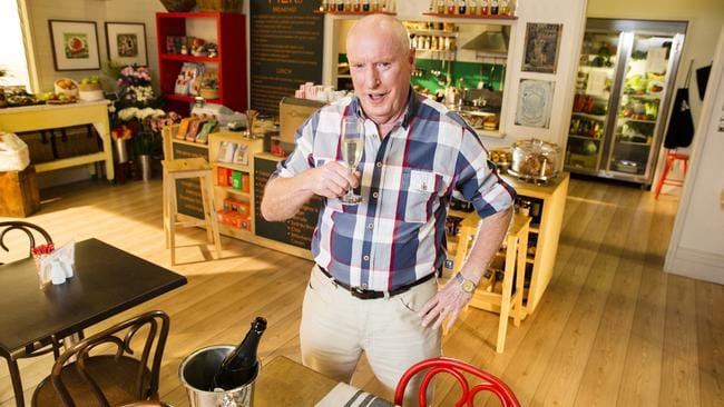 Cheers from all of us ... Ray Meagher toasts his 70th on the set of Home And Away. Picture: Justin Lloyd