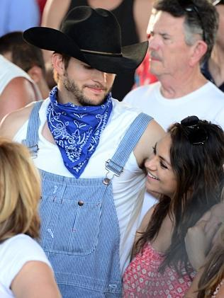 Mila has a chuckle at Ashton's outfit. Picture: Getty
