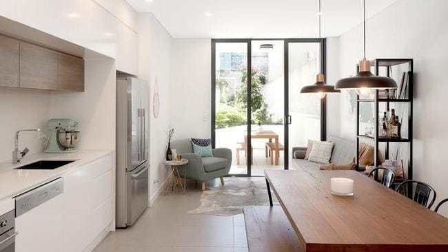 This inner-city two-bedroom unit at 43/153 George St, Redfern has a comparative guide of $925,000.