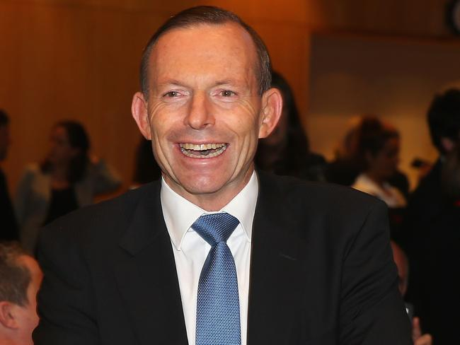 Tony Abbott finally axes the tax. Photo: Scott Barbour/Getty Images.