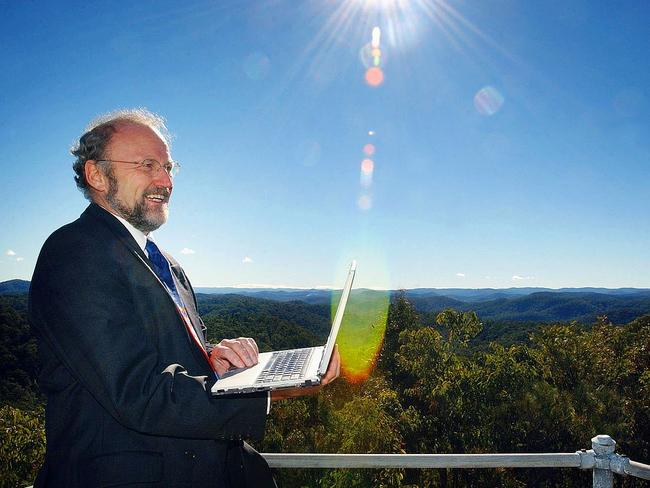 Broadband expert Paul Budde with his laptop on top of a mountain at Bucketty. Picture: Peter Clark