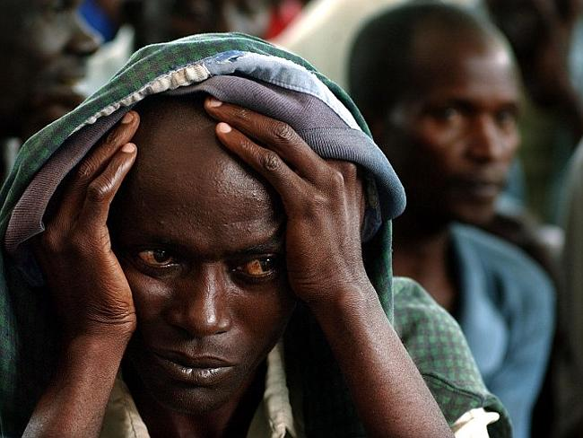 Former Rwandan prisoners of the solidarity camp in Gishamvu wait 05 May 2003, for the fin