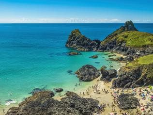 Cornwall tourists enjoying beach blue ocean Kynance Cove panorama UK