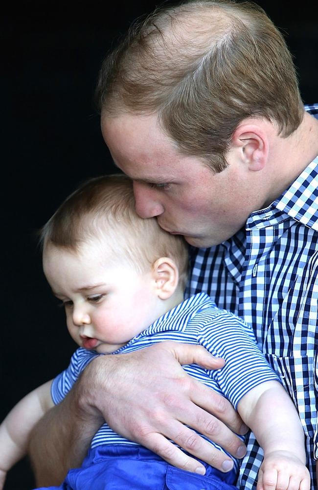 Prince William gives this little prince a bottle at night.