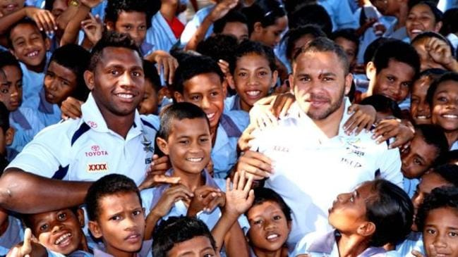 James Segeyaro (left) and then North Queensland Cowboys teammate Matt Bowen were mobbed by fans when they visited PNG in 2011.