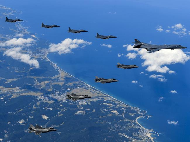 This US Army handout photo obtained September 23, 2017 shows Air Force and Marine Corps aircraft conducting a mission with the South Korean air force over the Korean Peninsula, on September 18, 2017. Picture: US Army/Steven Schneider/AFP