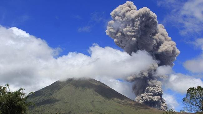 On February 2, 2013, the Lokon volcano spewed its thick, hot smoke 2000 metres into the air in a spectacular eruption. Picture: AFP