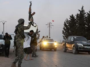 Turkish-backed Syrian rebels dance on a street in the northwestern border town of al-Bab on February 23, 2017 after they fully recaptured the town from the Islamic State (IS) group. Al-Bab, just 25 kilometres (15 miles) south of the Turkish border, was the last IS stronghold in the northern Syrian province of Aleppo. / AFP PHOTO / Nazeer al-Khatib