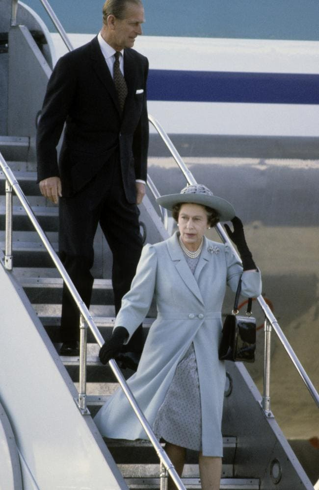 Queen Elizabeth ll and Prince Philip, Duke of Edinburgh arrive by aeroplane for a visit to Wellington, New Zealand in October 1981. Picture: Getty Images