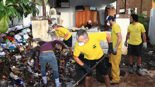 Council and contract workers clean up the Bobolas house following the drafting of new laws against hoarding. Picture: Adam Taylor