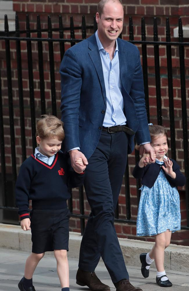 Princess Charlotte waves as she is led in with her brother Prince George by their father Prince William at the Lindo Wing of St Mary's Hospital. Picture: AFP