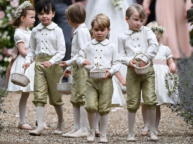 Prince George holds his petal basket along with the other kids. Picture: AFP PHOTO / Justin TALLIS