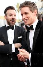 Jason Sudeikis and Eddie Redmayne attend the 88th Annual Academy Awards on February 28, 2016 in Hollywood, California. Picture: Getty