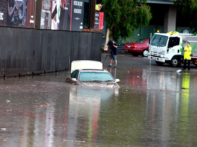 Flooding in Alexandra St, Bowen Hills on Wednesday afternoon. Photo: Chris McCormack.