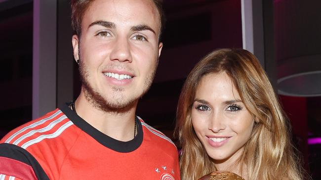 Goalscorer Mario Gotze of Germany and girlfriend Ann-Kathrin Brommel