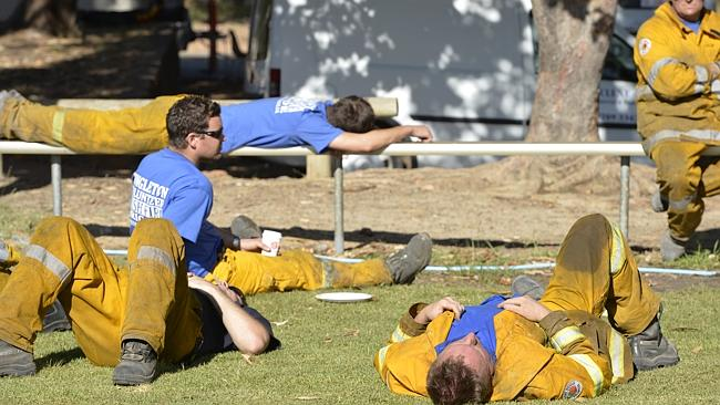 Exhausted emergency workers rest at the Parkerville operations centre. Picture: Stewart Allen