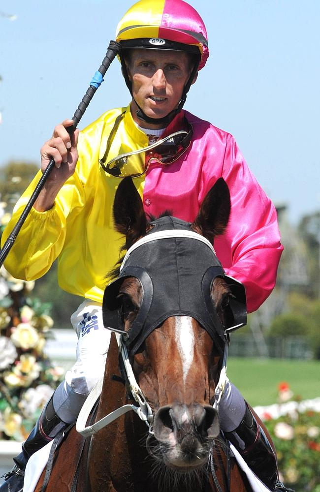 Nash Rawiller salutes after his victory on Earnest Ernest. Picture: Simon Bullard