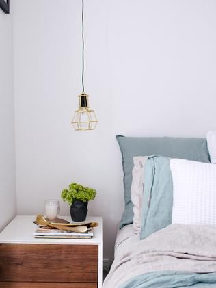 A simple metal frame around a bare bulb complements simple Scandi style. Photo: Hannah Blackmore www.hannahblackmorephotography.com via Adore Home magazine www.adoremagazine.com