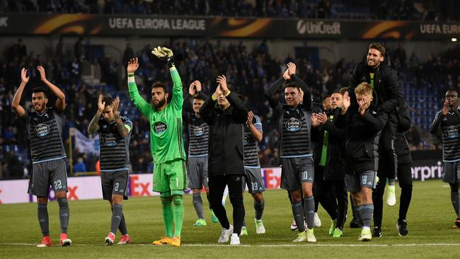 Celta's players celebrate.