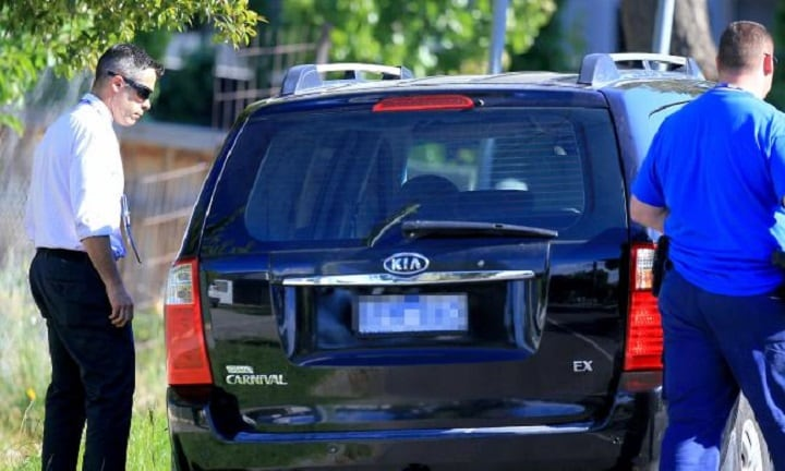 Police focus on a black Kia Carnival van. Picture: Mark Stewart