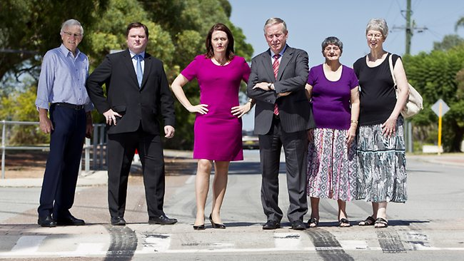 Drivers caught hooning in residential areas will have their cars confiscated permanently, if a Liberal Party is re-elected. High Wycombe residents Kevin Fitzgerald, Roma Giovinazzo and Pas Fitzgerald with Nathan Morton (Liberal for Forrestfield - 2nd left), Police Minister Liza Harvey and Premier Colin Barnett in Newburn Rd High Wycombe with tyre  marks . Picture: Matthew Poon