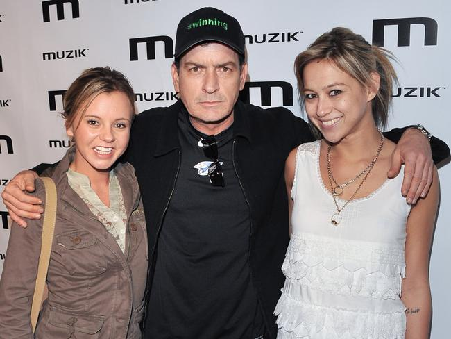 In the past ... Charlie Sheen with his then-girlfrnds Bree Olson and Natalie Kenly in 2011. Picture: Supplied