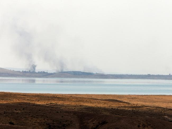 New strikes...Smoke rises in the horizon following US airstrikes targeting Islamic State (IS) militants at Mosul Dam on the outskirts of the northern city of Mosul, where insurgents are fighting Kurdish forces. Picture: AFP