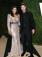 Paula Patton and Robin Thicke arrive at the 2013 Vanity Fair Oscar Party hosted by Graydon Carter at Sunset Tower on February 24, 2013 in West Hollywood, California. Picture: Getty