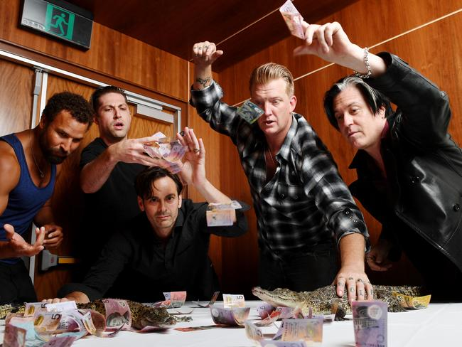 American rockers Queens of the Stone Age place their bets on a croc fight in Darwin. Picture: Elise Derwin