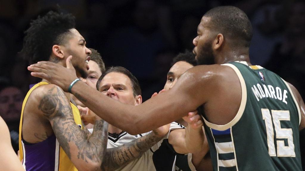 Los Angeles Lakers guard Nick Young, left, and Milwaukee Bucks centre Greg Monroe.