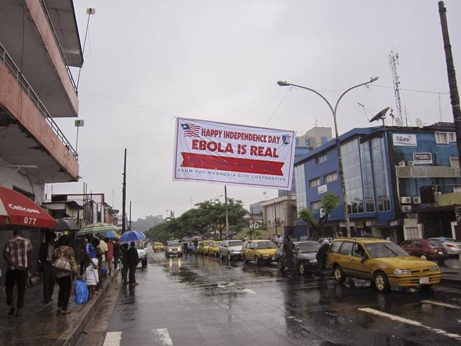 Deadly ... A banner warns people to be cautious about Ebola, in Monrovia, Liberia. Two American aid workers in Liberia have tested positive for the virus and are being treated there. Picture: AP