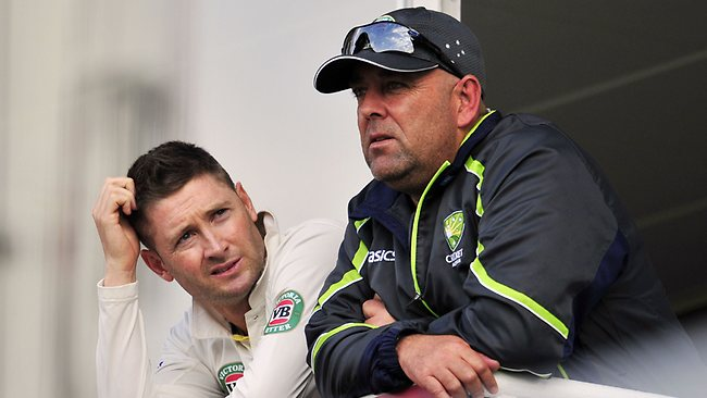 Australia's Michael Clarke (L) and Coach Darren Lehmann (R) watch from the balcony during play on the second day of the fifth Ashes cricket Test.
