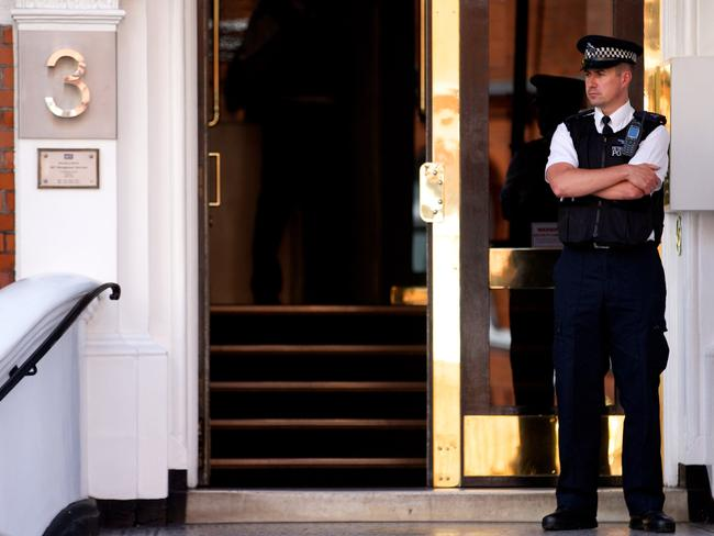 In limbo ... A policeman stands guard at the front door of the Ecuadorean Embassy in London on June 18, 2014 where Australian-born activist Julian Assange remains holed up after almost two years. Picture: AFP