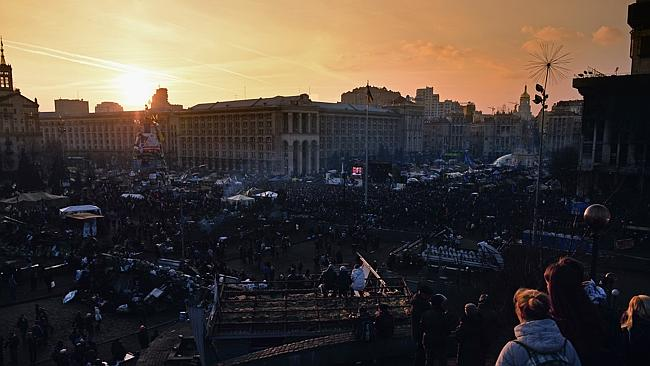 Peace deal...People gather as the sun sets over Independence Square on February 21, 2014 in Kiev. Picture: Getty