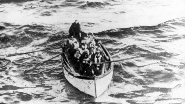 This dramatic picture was taken from the deck of the rescue vessel Carpathia at daybreak as Titanic survivors prepare to board.