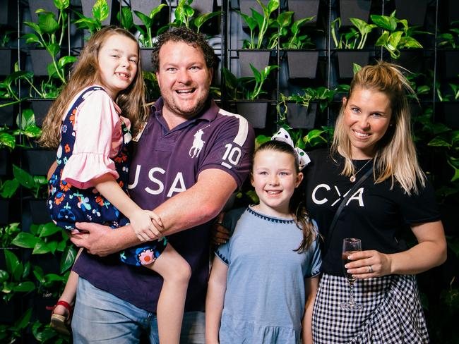 Cosi Costello with his daughters Matilda and Charli-Rose and wife Sam. Picture: James Elsby