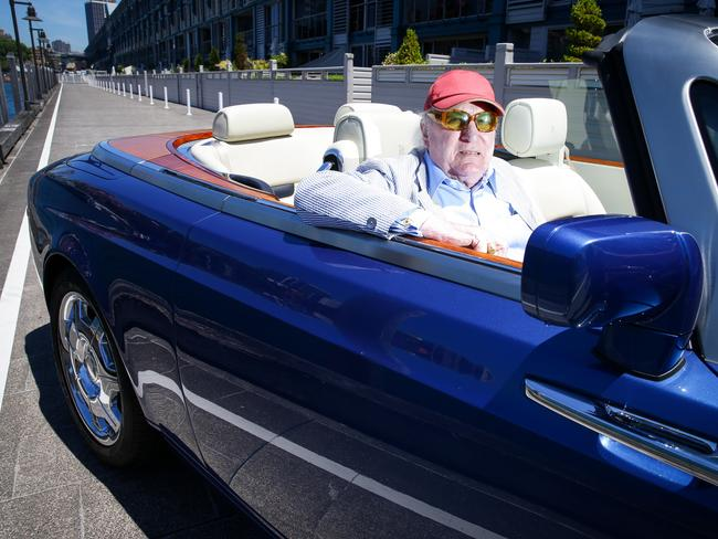 Clearly in touch with his listeners: John Laws in his Rolls Royce.