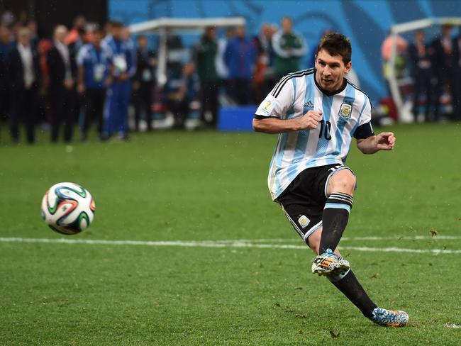 Lionel Messi scores his penalty in a shootout against the Netherlands during the 2014 World Cup semi-final.