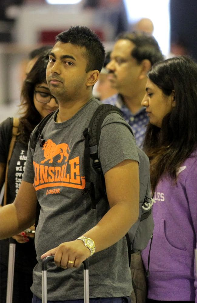 So sad ... Myuran Sukumaran's siblings make the heartbreaking journey from Sydney Airport.