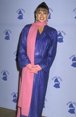 Worst ever Grammys outfits: Here come the 80s...Looking unrecognisable, Vanessa Williams rocks a floor length purple leather coat. Picture: Ron Galella/WireImage