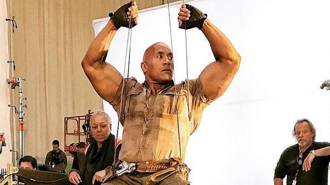 "Dwayne ""The Rock"" Johnson is ""forced"" to swing on wires for Jumanji. Picture: Instagram"